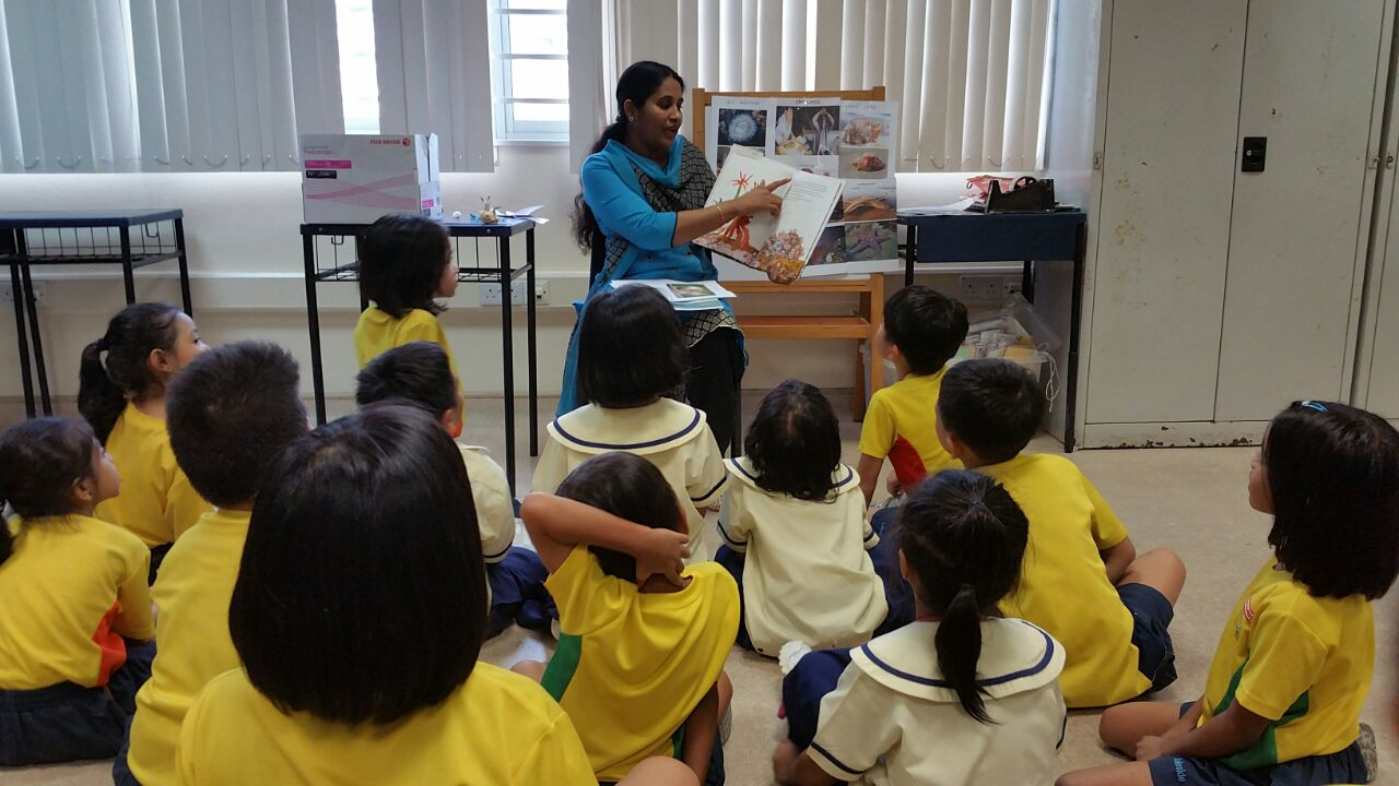 KidsRead - Parent Volunteer reading to students photo2.jpg